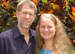 Photo of Jeff and Christi Boyd in front of an African textile.