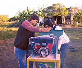 Elena Ramirez and Alicia Franco grinding corn Photo by Carola Tron