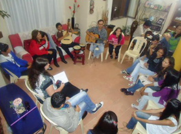 Pastor Eliézer (top right, with guitar) leads singing during fellowship with youth at his home in Tarija. Courtesy of Sarah Henken