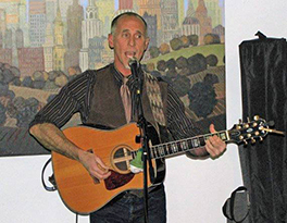 Rev. Tim Mooney plays at Community of One Photo by Erica MacCreaigh