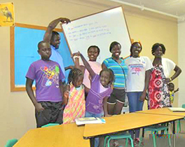Gilo G. Agwa teaching Anuak children in Stillwater, Minnesota, in the summer of 2013 Courtesy of Gilo G. Agwa