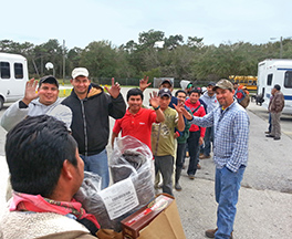 Farmworkers receiving assistance from Beth-El Photo by Dave Moore