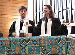 Rev. Lim and Rev. Sveet inviting the one body to the Lord's Table on World Communion Sunday Courtesy of Erik Swee