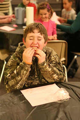 A boy enjoying a snack at the LOGOS program at First Central Presbyterian Church in Abilene Photo by David Baum