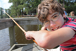 A young camper fishing at Camp Alabama Photo by Wes Cavin