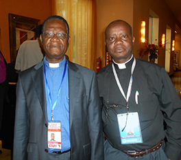 Seeking to build ecumenical relations, Rev. Manuel Nzoh, general secretary of the IRPGE (left), meets with Mr. Simon Dossou (right) at the All Africa Conference of Churches 10th General Assembly in Uganda in June 2013. Courtesy of Manuel Nzoh