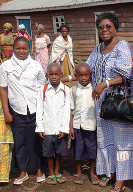 Rev. Nzeba reunites with a survivor and her five-year-old twin sons. Photo by Christi Boyd