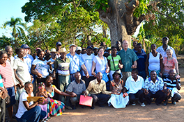 Members of the Presbytery of the Peaks mission team hand in hand with Haitian farmers who have been forced off their land Courtesy of Cindy Corell