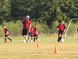 Rev. Brandon Bailey coaching youth soccer