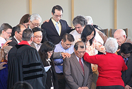 At First Taiwanese Presbyterian Church's chartering service, elders were commissioned with the laying on of hands.