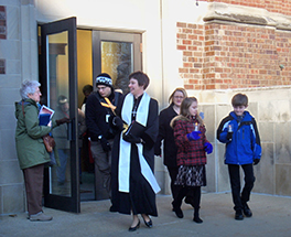 Rev. Beth Wagner and the congregation of First Presbyterian carry the cross and light of Christ to their new home Photo by Beth Wagner