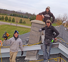 Lagom Landing students replacing the roof of an elderly person's home Photo by Laurel Nelson