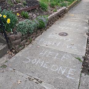 sidewalk with written chalk words
