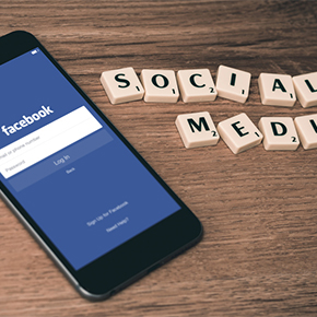 Facebook on cellphone and social media letters