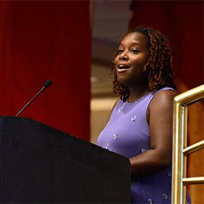African American woman speaking at podium