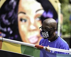 J. Herbert Nelson carring a BLM banner