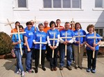 Volunteers wearing blue tshirts and holding crosses