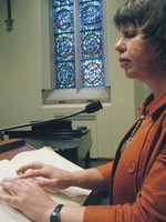 Lisa Larges, PDC member and Moderator of the Disability Concerns Ministry of the Presbytery of the Twin Cities Area, addresses a group in the chapel of Westminster Presbyterian Church in Minneapolis, MN, using her Braille notes.