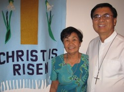 couple standing next to Easter banner