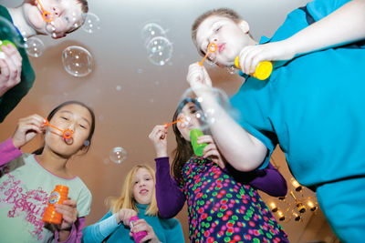 Children blowing bubbles pic