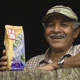A man with a bag of Equal Exchange coffee