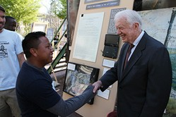 A man shaking Pres. Jimmy Carter's hand