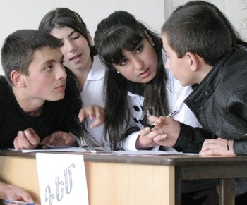 High school students, participants in the JMP Armenia initiated debate clubs, forming an argument in opposition of the debate subject in the city of Gavar, by Lois Aroian.