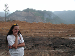 A woman at a strip mining site