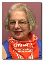 PW supporter wearing orange UNiTE scarf